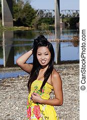 Asian American Woman Yellow Dress River Smiling