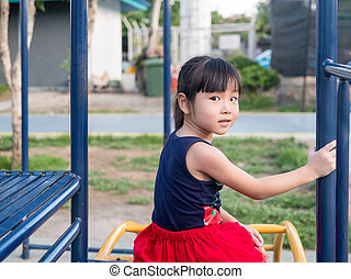 asian baby child playing on playground