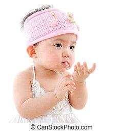 Asian baby girl eating