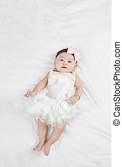 Asian baby girl laying on floor