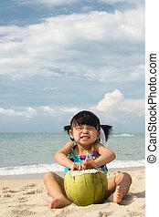 Asian baby girl on beach