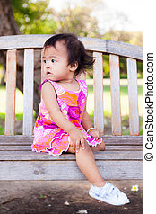 Asian baby girl sitting and look back - Asian baby girl ...