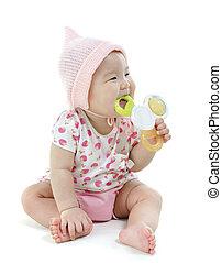 Asian baby girl teething
