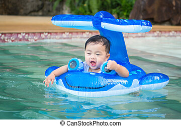 Asian baby play a water and swimming