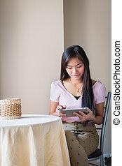 Asian beautiful women playing Tablets