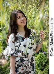 Asian beautiful young woman in the garden