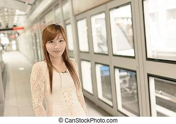 Asian beauty in MRT station, Taipei, Taiwan.