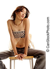 Asian beauty sitting on stool
