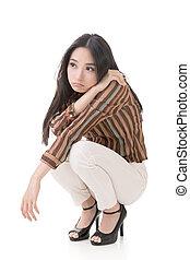 Asian beauty squat and feel boring