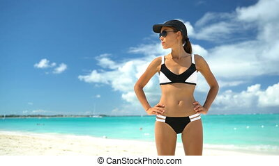 Asian bikini woman on beach summer vacation sporty swimwear girl in sportswear
