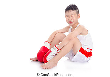 boxer boy sitting on the floor over white background