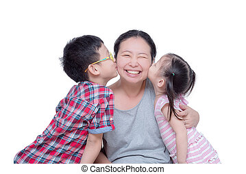 boy and girl kissing their mother over white
