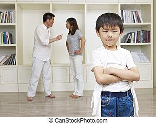 asian boy and quarreling parents