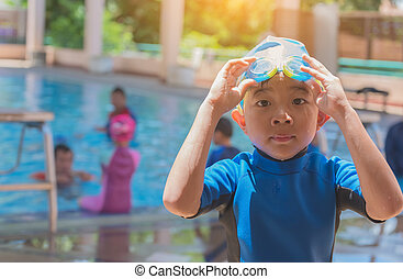 asian boy at swimming pool .