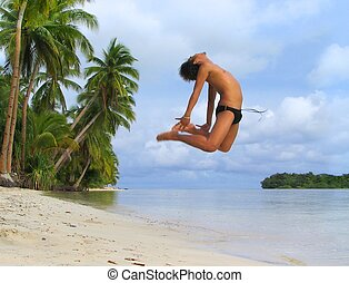 Asian boy cheer dancing on tropical beach - Asian boy...
