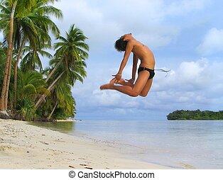 Asian boy cheer dancing on tropical beach