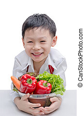 Asian boy chef and vegetable isolated on white background