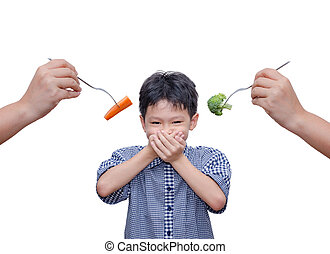Asian boy close his mouth by hands because don't want to eat vegetables