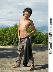 Asian boy fashion pose outdoors
