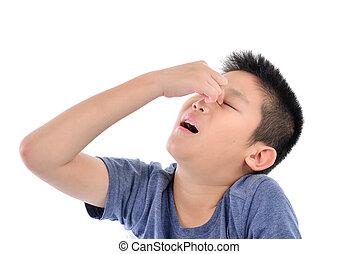 Asian boy has eye pain on white.