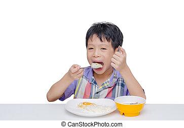 boy having breakfast on table
