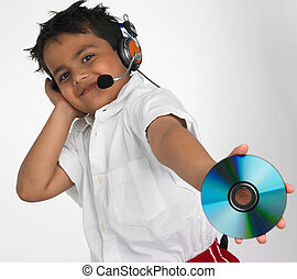 Asian boy holding a compact disc