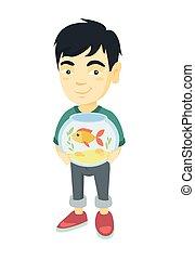 Asian boy holding aquarium with goldfish.