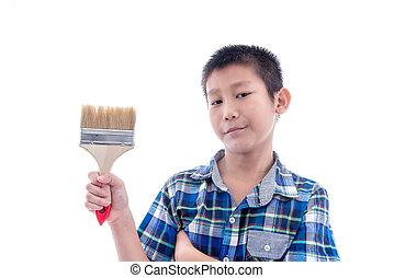 Asian boy holding brush in his hand on white.