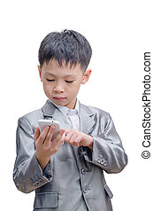 Asian boy in suit using mobile phone over white background