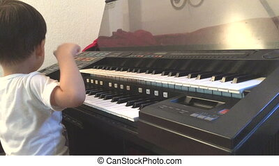 Asian boy learning to play electone