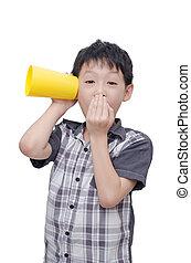 boy listening to conversation - Asian boy listening to ...