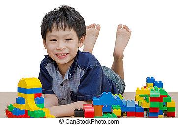 boy playing blocks on