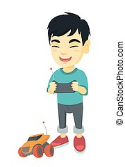 Asian boy playing with a radio-controlled car.