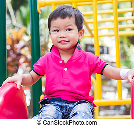 Asian boy relax in the park