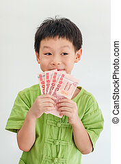 Asian boy thinking with holding Thai money on hand over white ba
