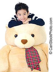 Asian boy with big bear dall .