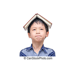 Asian boy with book on head thinking over white background