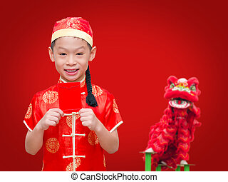 Asian boy with Chinese traditional dress holding ang pow or red