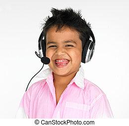asian boy with headphones an adorable asian boy of indian...