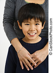 Asian boy with mother