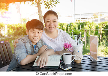 Asian boy with mother teaching and learning your homework at home