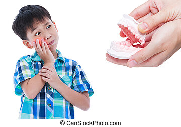 Asian boy with oral problem. Hand human holding dental mold. Isolated on white.