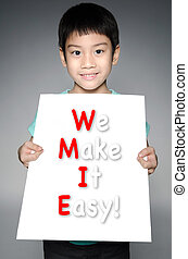 Asian boy  with WE MAKE IT EASY! message on white board
