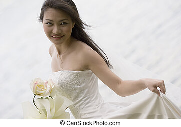 Asian Bride 19 - A beautiful young asian woman in a wedding...