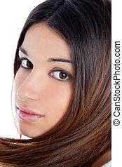 asian brunette indian woman with long hair closeup