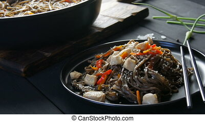 Asian buckwheat noodles soba with vegetables onion pods, ...