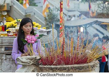 Asian Buddhist woman praying