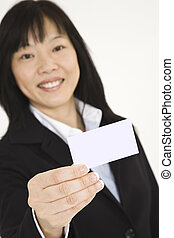 Beautiful Asian businesswoman holding a business card