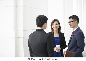 Asian Business colleagues talking - Happy Chinese Business...