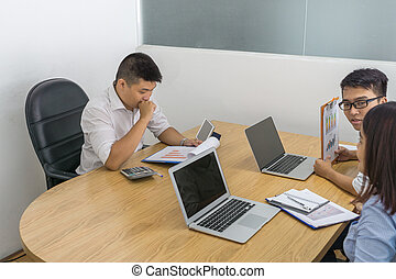 Asian business employee working in the meeting room